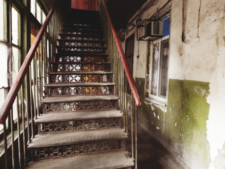 earthquake crack: An old metal staircase leading up in a poor quarter of the city