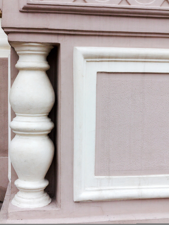 balustrades: Element of old plaster old balustrades. Gypsum balusters, as an element of external decorations Victorian, in the Empire style. Vintage architectural element as a background.