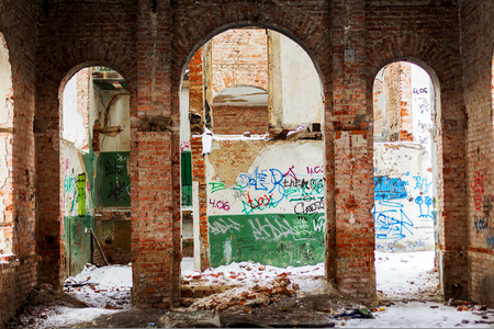 Odessa, Ukraine - 11 March 2013: Old building falling apart with broken windows, walls covered with cracks and scratches