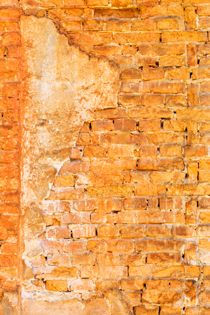 Empty Old Brick Wall Texture perspective. Painted Distressed Wall Surface. Grungy Wide Brickwall. Grunge Red Stonewall Background. Shabby Building Facade With Damaged Plaster. Abstract Web Banner. Copy Space. Stock Photo