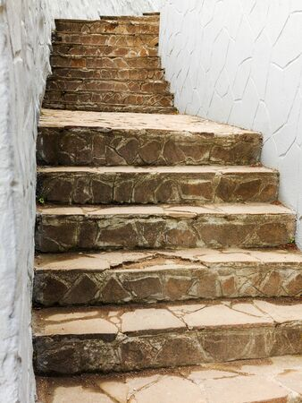 upstairs: Background old stairs made of natural stone leads upstairs