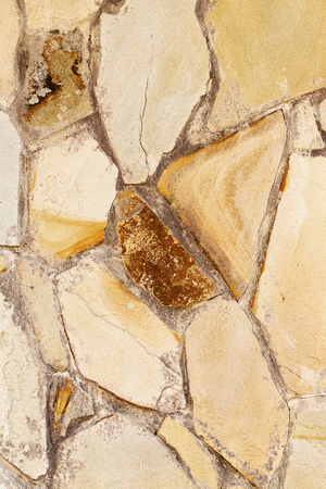 Abstract background of the old wall of black natural stone with cracks and scratches. Landscape style. Great background or texture. Stock Photo
