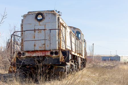 Old rusty steam locomotive. The crisis in Ukraine, the fall of the economy, stop production capacity. Global catastrophe.