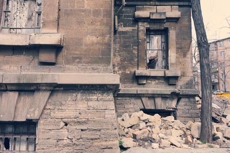 old brick wall: Landscape with an abandoned, collapsing building in the city Stock Photo