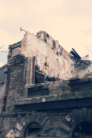 Landscape with an abandoned, collapsing building in the city Stock Photo