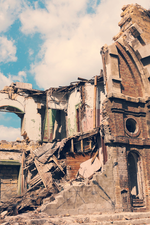 the collapsing: Landscape with an abandoned, collapsing building in the city Stock Photo