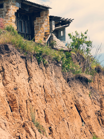 landslide caused by torrential rains of hurricane CHRISTIE. Broken road asphalt cracked, and came down with landslide. Destroyed residential buildings of cottage town elite settlement. earthquake