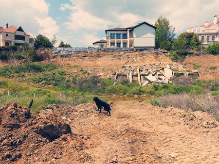elite: landslide caused by torrential rains of hurricane CHRISTIE. Broken road asphalt cracked, and came down with landslide. Destroyed residential buildings of cottage town elite settlement. earthquake