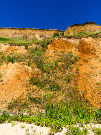 Landslide zone on Black Sea coast. Zone of natural disasters during rainy season. Large masses of earth slip along slope of hill, destroy houses. Landslide - threat to life