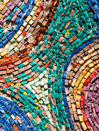 bathroom design: Detail of beautiful old collapsing abstract ceramic mosaic adorned building. Venetian mosaic as decorative background. Selective focus. Abstract Pattern. Abstract mosaic colored ceramic stones