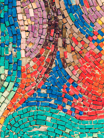 the collapsing: Detail of beautiful old collapsing abstract ceramic mosaic adorned building. Venetian mosaic as decorative background. Selective focus. Abstract Pattern. Abstract mosaic colored ceramic stones