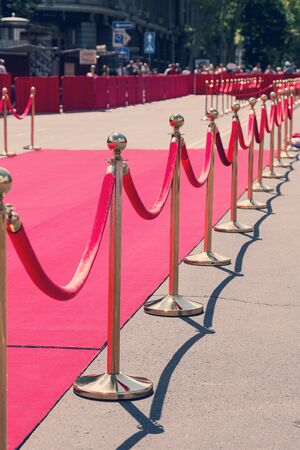 velvet rope barrier: Way to success on the red carpet (Barrier rope). Toning. Selective focus