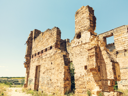 Mystical Interior, ruins of facade of an abandoned ruined building of an ancient castle 18th century. Old ruined walls, corridor with garbage and mud. Ruins Ancient historic building destroyed by war