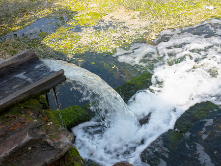 Sewage drains into the river, the sea, the lake. Environmental pollution. Wastewater, ecological catastrophe