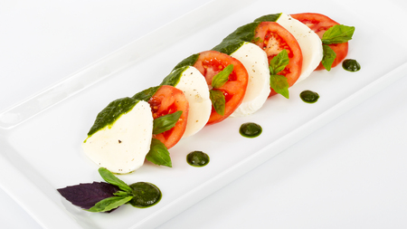 expensive: Delicious gourmet food on the table. Gourmet cuisine in white dish. Creative restaurant concept.