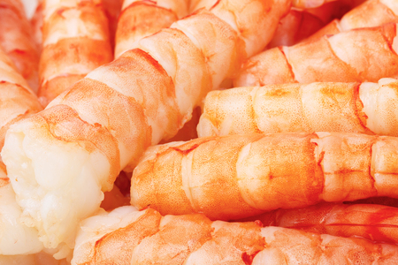 Tiger prawns. Delicious gourmet food on the table. Gourmet cuisine in white dish. Creative restaurant concept.