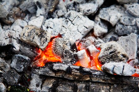 smolder: Wooden embers beautifully glowing. Charcoal embers ready for barbecue Stock Photo