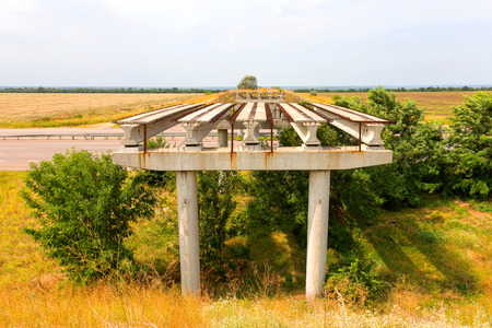 Abandoned unfinished bridge over the motorway. Overpass. The construction of the bridge. The destroyed bridge.