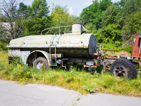 vandalism: Radioactive dead zone of Chernobyl. Abandoned looted appliances, cars, electronics in Chernobyl accident. Consequences of evacuation, looting and vandalism after an explosion Stock Photo