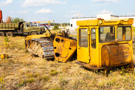 Radioactive dead zone of Chernobyl. Abandoned looted appliances, cars, electronics in Chernobyl accident. Consequences of evacuation, looting and vandalism after an explosion Stock Photo