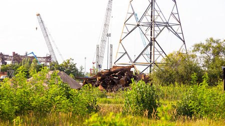 Huge pile of scrap metal junk garbage with blue sky background. Scrap metal on recycling plant site. Chernobyl Stock Photo