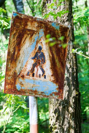 nuclear bomb: Old rusty metal signs in the Chernobyl zone. Radioactive area. Warning about dangerous area