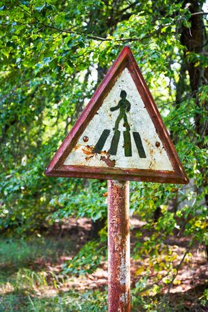 Old rusty metal signs in the Chernobyl zone. Radioactive area. Warning about dangerous area