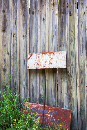 Inscription  Stop shooting. Old rusty metal signs in the Chernobyl zone. Radioactive area. Warning about dangerous area