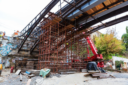 Odessa, Ukraine - October 11, 2016: Bridge repair. Metallicheskie support of the bridge. Carried out scheduled repair work on the reconstruction of the old town bridge.