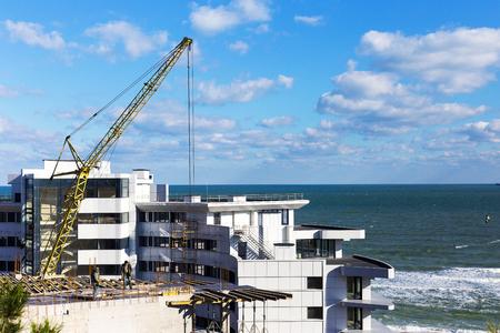 ODESSA, UKRAINE - October 17, 2016: Construction of multistory hotel on the Black sea coast. Editorial