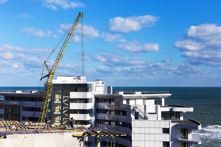 ODESSA, UKRAINE - October 17, 2016: Construction of multistory apartment buildings on the Black sea coast. Editorial