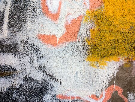 plastered wall: Abstract, damage to walls with many colors. Style of landscape. Rough concrete surface with cracks, scratches and paint stains. Great background or texture. Stock Photo