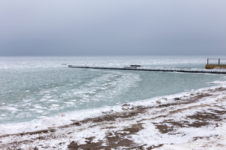 Sea covered with broken ice. Front focus. Black sea in winter Stock Photo