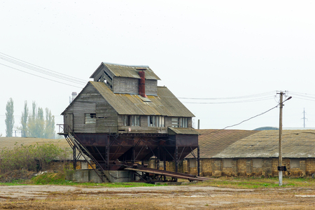 An old abandoned ruined granary, grain elevator. Rural landscape. Editorial