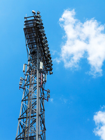 Stadium light against blue sky
