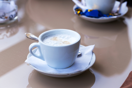 Cup of coffee. Morning atmospheric lighting, fashionable trendy spot soft focus. Preparation for design creative menu. Stock Photo