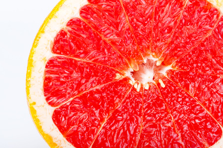 Grapefruit citrus fruit with half on white with clipping path