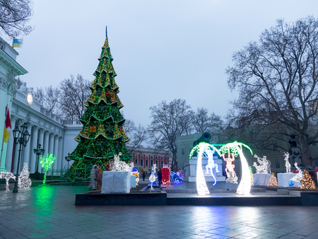Odessa, Ukraine - January 14, 2016: Exquisite Christmas and New Year decorations and Christmas trees on the streets and in parks with blur bokeh. Great Christmas background.