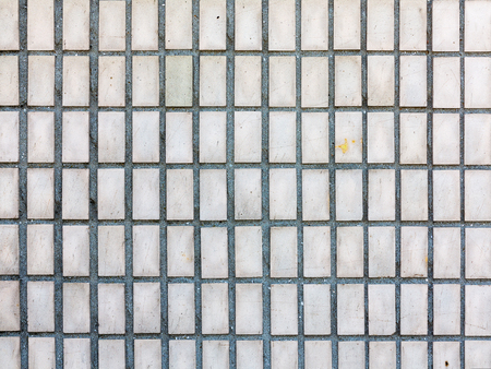 Old outdoor facing tiles for buildings. Abstract geometric architectural background. Banco de Imagens