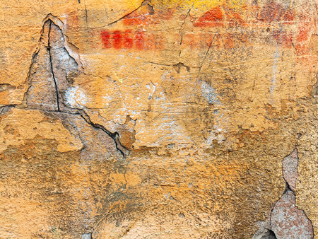 Background of old cracked walls with graffiti