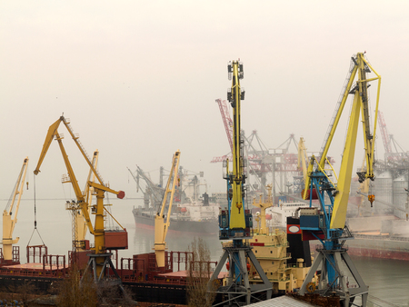 Industrial container freight trade port scene in foggy cloudy day Archivio Fotografico
