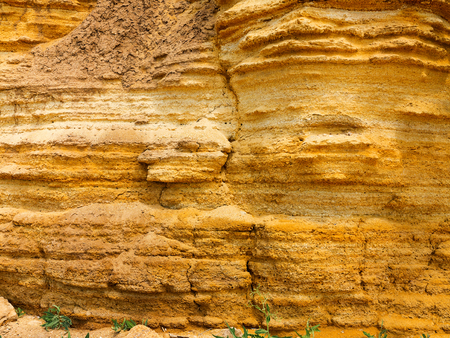 Desert landscape with multi-colored yellow, green and blue clay deposits of minerals in geological formations