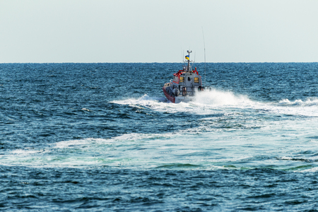 A rescue boat in the sea monitors the safety of tourists on the water and stops violators of order and safe rest. Sea boat coastal beach rescue patrol service