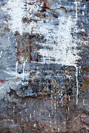 Background texture wall with peeling old paint. Old wooden background with remains of pieces of scraps of old paint on wood. Texture of an old tree, board with paint, vintage background peeling paint