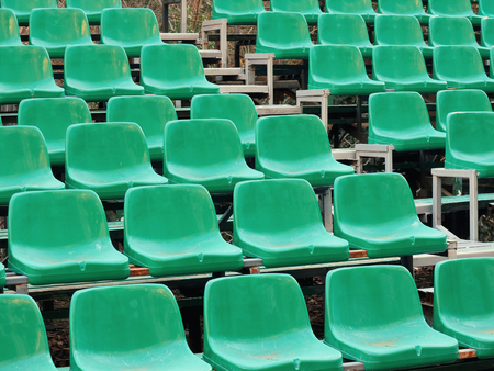 Amphitheater dark green seats abstract background. Places in the stands of the stadium