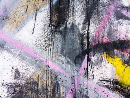 Rough paint dripping, spray paint artwork. Abstract background oil paint painting style. Damage to walls with many colors. Rough concrete surface with cracks, scratches and paint stains Stockfoto