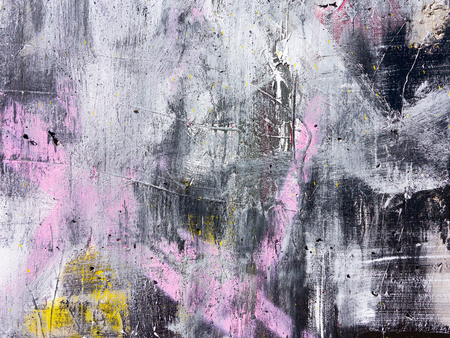 Rough paint dripping, spray paint artwork. Abstract background oil paint painting style. Damage to walls with many colors. Rough concrete surface with cracks, scratches and paint stains