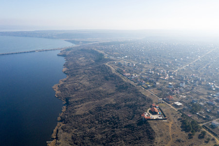 Beautiful landscape from above in haze. Ð¡oast of the Khadzhibey estuary in early spring from a bird's eye view not far from Odessa.