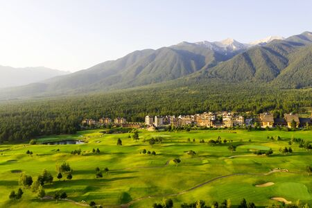 Aerial view from the drone. Stunning mountain and countryside view shot from a drone in the morning at dawn. Beautiful landscape of sunrise, the mountains in the haze