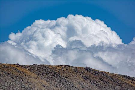 Amazingly beautiful clouds over the mountain Фото со стока